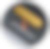 Illustration demonstrating insertion of brass medallion through the bottom of the Grovemade x Keycult Desk Pad.
